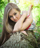 Portrait of young beautiful woman in forest — Stock Photo