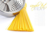 Bunch of spaghetti and pan on a white background — Stock Photo
