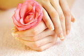 Closeup image of pink french manicure with rose — Stock Photo