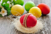 Colorful Easter eggs on a wooden table old — Photo