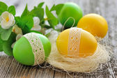 Colorful Easter eggs on a wooden table old — Stock Photo