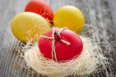 Easter eggs on a old wooden background — Stock Photo