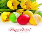Easter eggs with tulips on white background (with sample text) — Стоковое фото