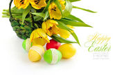 Easter eggs with tulips on white background (with sample text) — Stock Photo