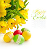 Easter eggs with tulips on white background (with sample text) — Stok fotoğraf