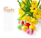 Easter eggs with tulips on white background (with sample text) — Zdjęcie stockowe