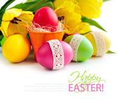 Easter eggs with tulips on white background (with sample text) — Stockfoto