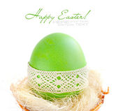 Easter eggs in a nest on white background — Stock Photo