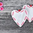 Two hearts with flowers on a wooden background old — Stock Photo #46225153