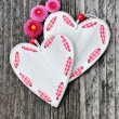 Two hearts with flowers on a wooden background old — Stock Photo #46225187