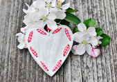 Spring Blossom and heart over wooden background — Stock Photo