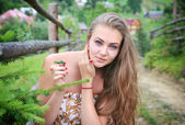 Portrait of an young beautiful woman on the nature — Stock Photo
