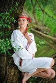 Beautiful young girl in folk costume — Stock fotografie