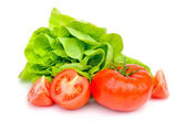 Fresh tomatoes and green salad isolated on white background — Stockfoto