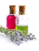 Aroma oil with lavender flowers on a white background — Stockfoto