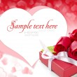 Little red gift with roses on background hearts — Stock Photo #8474406