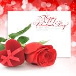 Red velvet Heart-shaped Gift Box and rose on a festive backgroun — Stock Photo #8939562