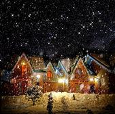 Inredda hus med julbelysning — Stockfoto