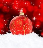 Red Christmas Ball on black — Stock Photo