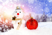 Christmas snow men and christmas ball — Stock Photo