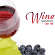 Branch of grapes and glass of wine - Stock Photo