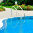 Swimming pool with stair at hotel close up — Stock Photo #17664689