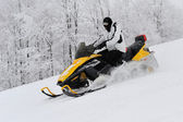 Man on snowmobile — Stock Photo