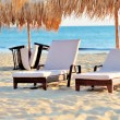 Stock Photo: Two beach chairs with white umbrella
