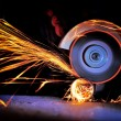 Worker cutting metal with grinder — Stock Photo #22769842