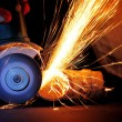Worker cutting metal with grinder — Foto Stock