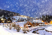 Houses decorated and lighted for christmas at night — Stock Photo