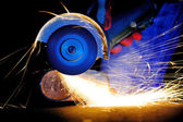 Worker cutting metal with grinder — Stock Photo