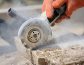 Grinder worker cuts a stone — Stock Photo