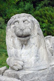 Stony chapped figure of lion at entrance to Olesko Castle — Stock Photo