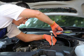 Car mechanic in auto repair service — Photo