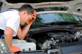 Car mechanic in auto repair service — Stockfoto