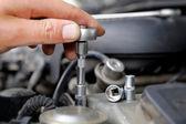Hands of car mechanic — Стоковое фото