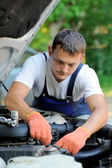 Car mechanic in auto repair service — Stock Photo