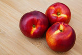 Nectarines on wooden table — Stock fotografie