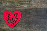 Floral felt red heart on wooden background — Stock Photo