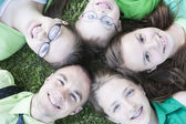 Brothers and Sisters lying in the grass — Stock Photo