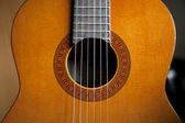 Classical guitar soundboard pink strings — Stock Photo
