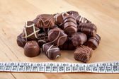 Chocolates - counting calories — Stock Photo