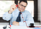 Man in office draws a graph uphill — Stock Photo