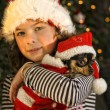 Girl with christmas dog — Stock Photo