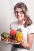 Girl with pumpkins — Stock Photo
