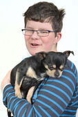 Boy with small dog — Stock Photo