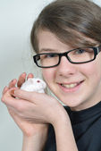 Girl with hamster — Stock Photo