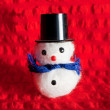 Christmas snowman on red background — Stock Photo