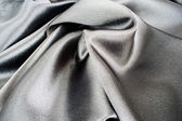 Black silk satin for background — Stock Photo